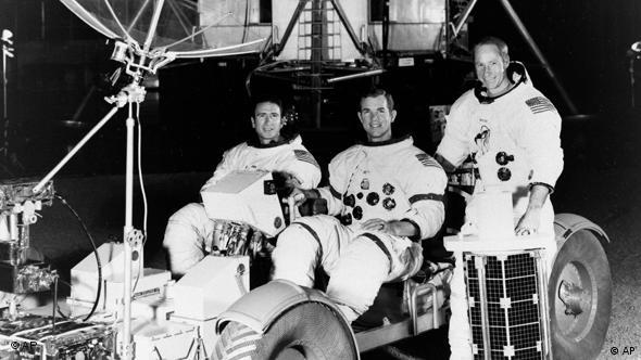 A black-and-white press photo shows Apollo 15 astronauts in a mock picture of a future moon landing.
