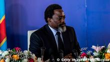 President of the Democratic Republic of Congo, Joseph Kabila, holds a press conference for the first time in five years on January 26, 2018 in Kinshasa. DR Congo President Joseph Kabila on January 26 stood by the timetable for delayed elections despite demands that he step down ahead of the poll. / AFP PHOTO / THOMAS NICOLON (Photo credit should read THOMAS NICOLON/AFP/Getty Images)