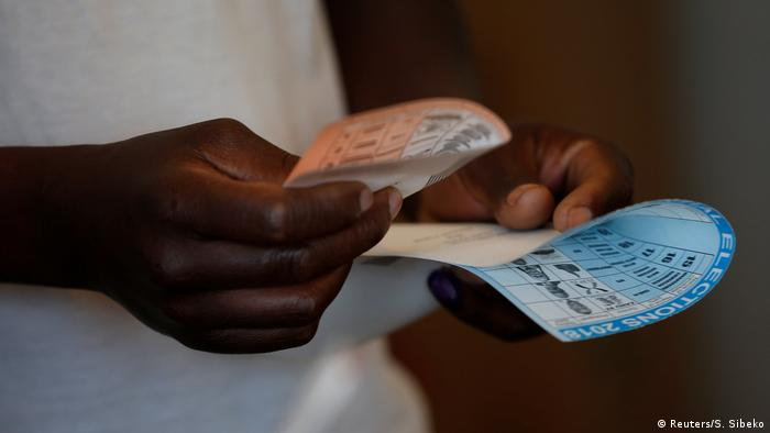 Hands holding ballot papers in Zimbabwe