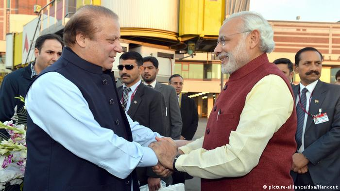 Indian Prime Minister Narendra Modi (R) being welcomed by the Prime Minister of Pakistan, Nawaz Sharif (L), at the airport in Lahore, Pakistan, 25 December 2015