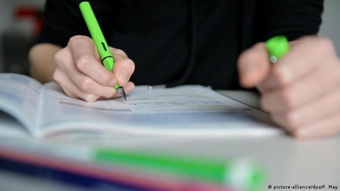 A boy does homework
