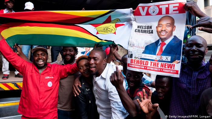 Supporters cheer outside the MDC headquarters