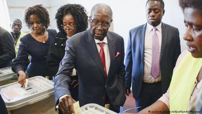 Former Zimbabwean President Robert Mugabe and his wife Grace cast their ballots