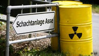Radioactive waste drum by road sign