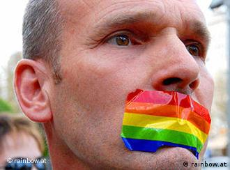 Man with his mouth taped closed with rainbow tape