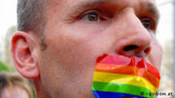 A man with rainbow tape on his mouth