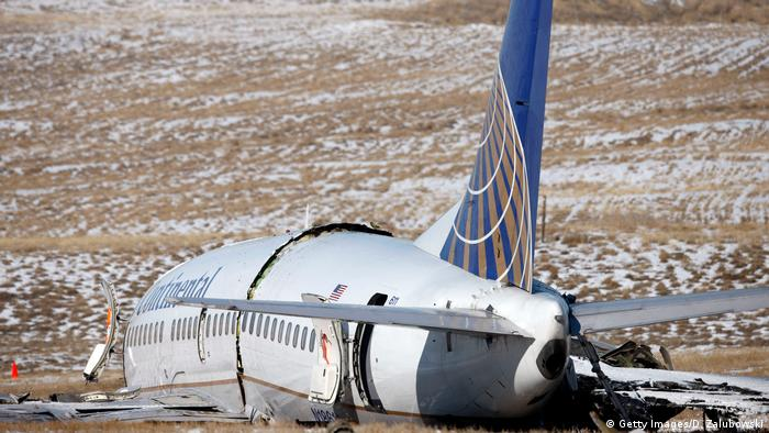 The wreckage of a Continental Airlines plane sits in a ravine