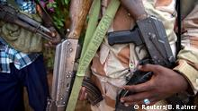 27.04.2017 FILE PHOTO: An armed fighter belonging to the 3R armed militia displays his weapon in the town of Koui, Central African Republic, April 27, 2017. REUTERS/Baz Ratner/File Photo