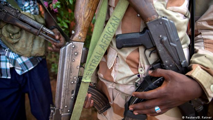 Close-up of people holding weapons