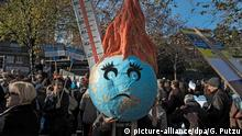 epa05047221 A handicraft world globe looks sad and has fever during a protest for the global climate day in Lugano, Switzerland, 29 November 2015. Climate change protesters march through Lugano during a demonstration in the southern part of Switzerland. World leaders are to meet for the The 21st Conference of the Parties (COP21) due to be held in Paris from 30 November to 11 December. EPA/GABRIELE PUTZU +++(c) dpa - Bildfunk+++ |