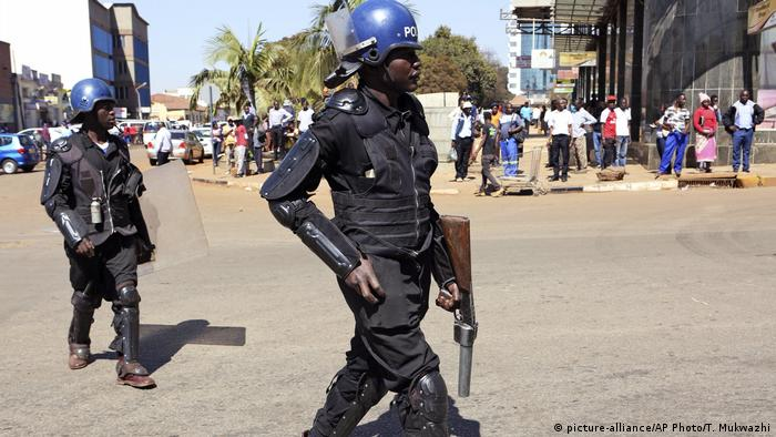 Armed riot police patrolling the streets of Harare