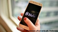 hand holding cellphone that reads #metooo (picture alliance/dpa/B. Pedersen)