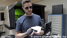 Aug. 1, 2018*** Cody Wilson, with Defense Distributed, holds a 3D-printed gun called the Liberator at his shop, Wednesday, Aug. 1, 2018, in Austin, Texas. A federal judge in Seattle issued a temporary restraining order Tuesday to stop the release of blueprints to make untraceable and undetectable 3D-printed plastic guns. (AP Photo/Eric Gay) |