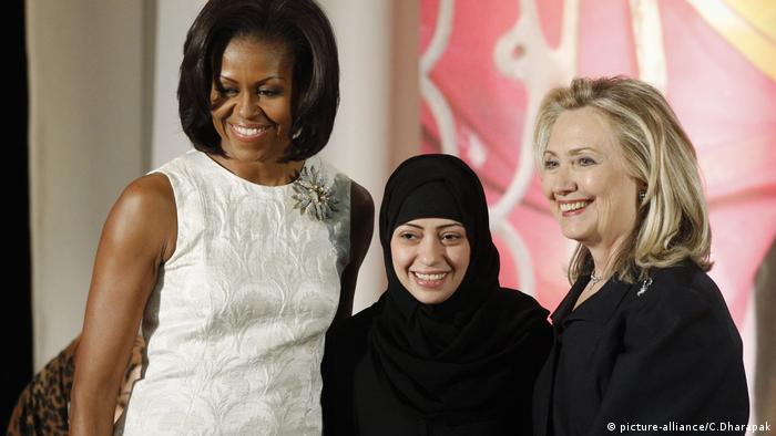 Hillary Rodham Clinton, Michelle Obama, Samar Badawi (picture-alliance/C.Dharapak)