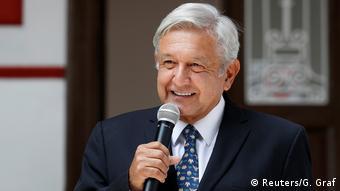 Andres Manuel Lopez Obrador speaks into a microphone