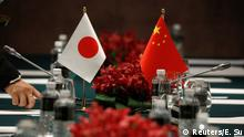 Japanese and Chinese flags are pictured after a bilateral meeting between two countries on the sidelines of the ASEAN Foreign Ministers' Meeting in Singapore August 2, 2018. REUTERS/Edgar Su