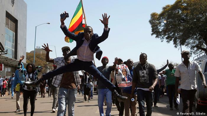 Supporters of Zimbabwe's opposition marching through the capital Harare