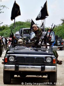 Hooded Al-Shabab militants riding a truck in Mogadishu