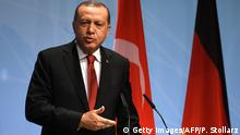 Turkey's President Recep Tayyip Erdogan attends a final press conference on the second day of the G20 Summit in Hamburg, Germany, July 8, 2017. Leaders of the world's top economies gather from July 7 to 8, 2017 in Germany for likely the stormiest G20 summit in years, with disagreements ranging from wars to climate change and global trade. / AFP PHOTO / Patrik STOLLARZ (Photo credit should read PATRIK STOLLARZ/AFP/Getty Images)