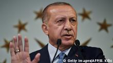 Turkish President Recep Tayyip Erdogan delivers a speech on June 24, 2018 in Istanbul, after initial results of Turkey's presidential and parliamentary elections. - Erdogan on June 24 declared victory in a tightly-contested presidential election, extending his 15-year grip on power in the face of a revitalised opposition. Turkish voters had for the first time cast ballots for both president and parliament in the snap polls, with Erdogan looking for a first round knockout and an overall majority for his ruling Justice and Development Party (AKP). (Photo by Bulent Kilic / AFP) (Photo credit should read BULENT KILIC/AFP/Getty Images)