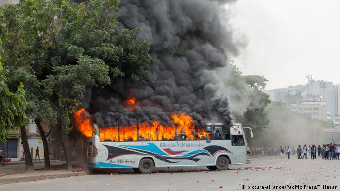 A bus in Dhaka in flames