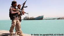 Pro-government forces walk in the port of the western Yemeni coastal town of Mokha as they advance in a bid to try to drive the Shiite Huthi rebels away from the Red Sea coast on February 9, 2017. Forces supporting President Abedrabbo Masnour Hadi, backed by the coalition, began a major offensive on January 7 to recapture the coastline overlooking the strategic Bab al-Mandab Strait. / AFP / SALEH AL-OBEIDI (Photo credit should read SALEH AL-OBEIDI/AFP/Getty Images)