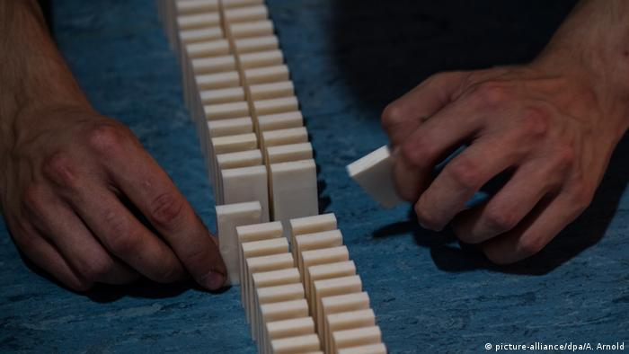 Someone lays titles down at a domino world record attempt in Nidda
