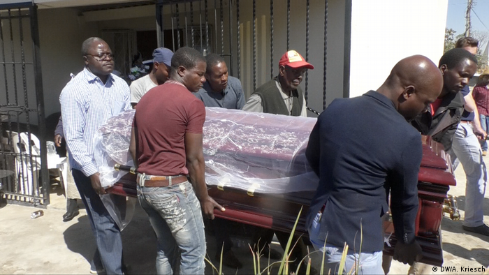 Mourners carry Sylvia Maphosa's coffin