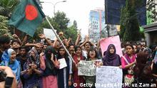 Bangladeshi students shout slogans as they march along a street during a student protest in Dhaka on August 5, 2018, following the deaths of two college students in a road accident. - Bangladesh Prime Minister Sheikh Hasina urged students on August 5 to go home as police fired tear gas during an eighth day of unprecedented protests over road safety which have paralysed parts of Dhaka. (Photo by Munir UZ ZAMAN / AFP) (Photo credit should read MUNIR UZ ZAMAN/AFP/Getty Images)