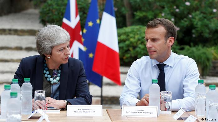 Theresa May with Emmanuel Macron (Reuters)
