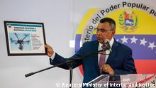 Venezuela's Interior and Justice Minister Nestor Reverol holds a placard with a picture of a drone during a news conference in Caracas, Venezuela August 5, 2018. Ministry of Interior and Justice/Handout via REUTERS ATTENTION EDITORS - THIS PICTURE WAS PROVIDED BY A THIRD PARTY.