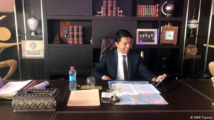 Andry Rajoelina, presidential candidate in Madagascar, sitting at his desk