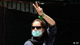 A woman gives a peace sign during a protest