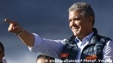 20.05.2018 FILE - In this May 20, 2018 file photo, presidential candidate Ivan Duque acknowledges supporters during a campaign rally in Bogota, Colombia. Uncertainty loomed over Colombia's fragile peace deal on Monday, June 18, 2018, with Duque's victory, one of its most hawkish critics. (AP Photo/Fernando Vergara, File) |