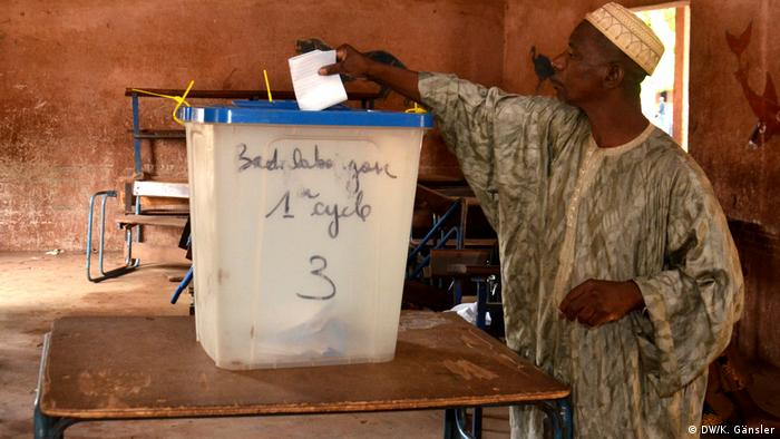 A voter casting his ballot in the first round on July 29