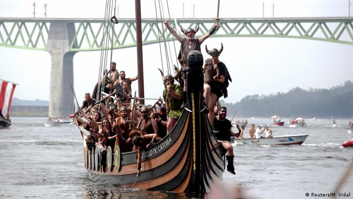 People dressed as Vikings boat during the annual Viking festival of Catoira in north-western Spain