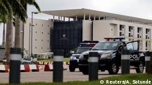 Police vehicles are pictured outside the National Assembly in Abuja, Nigeria August 7, 2018. REUTERS/Afolabi Sotunde