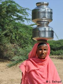 A woman with water vessels on her head