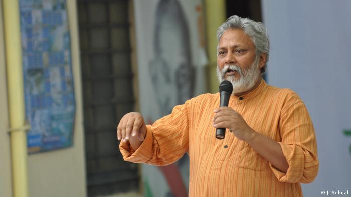 Rajender Singh speaking at a conference
