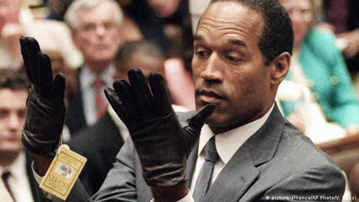 n this June 21, 1995 file photo, O.J. Simpson holds up his hands before the jury after putting on a new pair of gloves similar to the infamous bloody gloves during his double-murder trial in Los Angeles. (AP Photo/Vince Bucci, Pool, File)