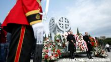 August 8, 2018*** Honor Guard stands at attention during a wreath laying ceremony on the 10th anniversary of Georgian-Russian war at the memorial cemetery of the Georgian soldiers killed during the war in Tbilisi, Georgia, August 8, 2018. REUTERS/David Mdzinarishvili