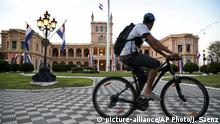 A biker rides past Paraguay's Government Presidential Palace Casa de Lopez in Asuncion, Paraguay, Monday, May 28, 2018. Paraguay's President Horacio Cartes has resigned from the presidency of Paraguay, a long-expected step that paves the way for him to take a Senate seat. The recently approved Vice President Alicia Pucheta will take over as leader. (AP Photo/Jorge Saenz) |
