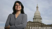 FILE - In this Thursday, Nov. 6, 2008, file photo, Rashida Tlaib, a Democrat, is photographed outside the Michigan Capitol in Lansing, Mich. In the primary election Tuesday, Aug. 7, 2018, Democrats pick former Michigan state Rep. Rashida Tlaib to run unopposed for the congressional seat that former Rep. John Conyers held for more than 50 years. Tlaib would be the first Muslim woman in Congress. (AP Photo/Al Goldis, File)  