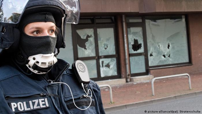 A policewoman stands in front of a mosque in Hildesheim that was shuttered by authorities in March, 2017.