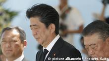 Japanese Prime Minister Shinzo Abe, center, has a moment of silence during a ceremony at Nagasaki Peace Park in Nagasaki, southern Japan Thursday, Aug. 9, 2018, marking the 73rd anniversary of the bombing on the city. (Miyuki Saito/Kyodo News via AP) |