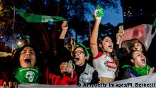 Activists in favour of the legalization of abortion demonstrate outside of the Argentine Embassy, Chile, on August 08, 2018. - Argentine lawmakers geared up Wednesday for a key vote on legalizing abortion amid fiercely polarized campaigns for and against the bill in the traditionally Roman Catholic country. (Photo by Martin BERNETTI / AFP) (Photo credit should read MARTIN BERNETTI/AFP/Getty Images)