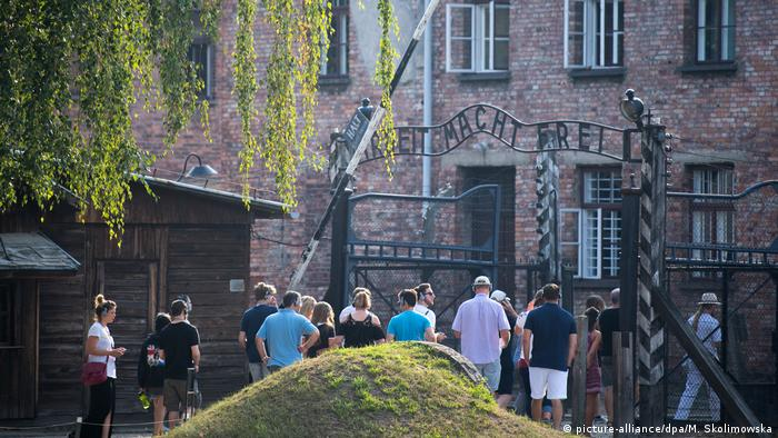 A group of people visits the Auschwitz memorial