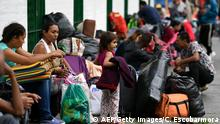 Venezuelan migrant families are seen at a makeshift camp alongside the Cali river in northern Cali, Colombia, on July 31, 2018. - Near 400 Venezuelan migrants, staying in Cali are preparing to leave to Ecuador or Peru. Those who do not wish to leave the country will have to go through a formal process before Colombian Migration authorities to legalise their status. (Photo by Christian EscobarMora / AFP) (Photo credit should read CHRISTIAN ESCOBARMORA/AFP/Getty Images)