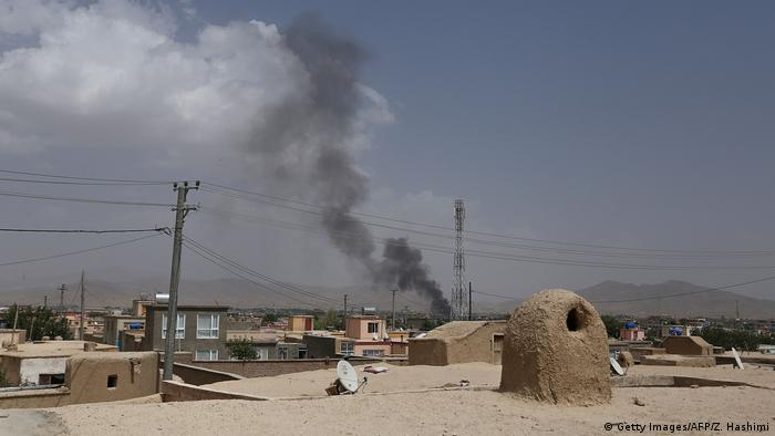 Smoke rising over the city of Ghazni, Afghanistan during fighting between government forces and the Taliban (Getty Images/AFP/Z. Hashimi)