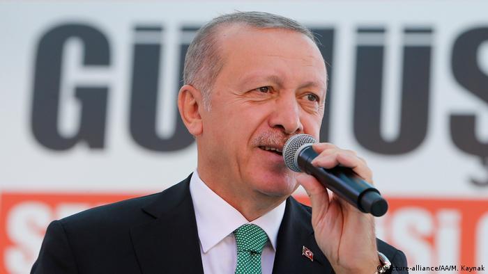 Turkish President Recep Tayyip Erdogan speaking into a microphone